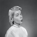 UNITED STATES - Circa 1950s:  Blonde Woman Page Boy Hair Pearl Necklace White Blouse 3 4 Profile Loo...