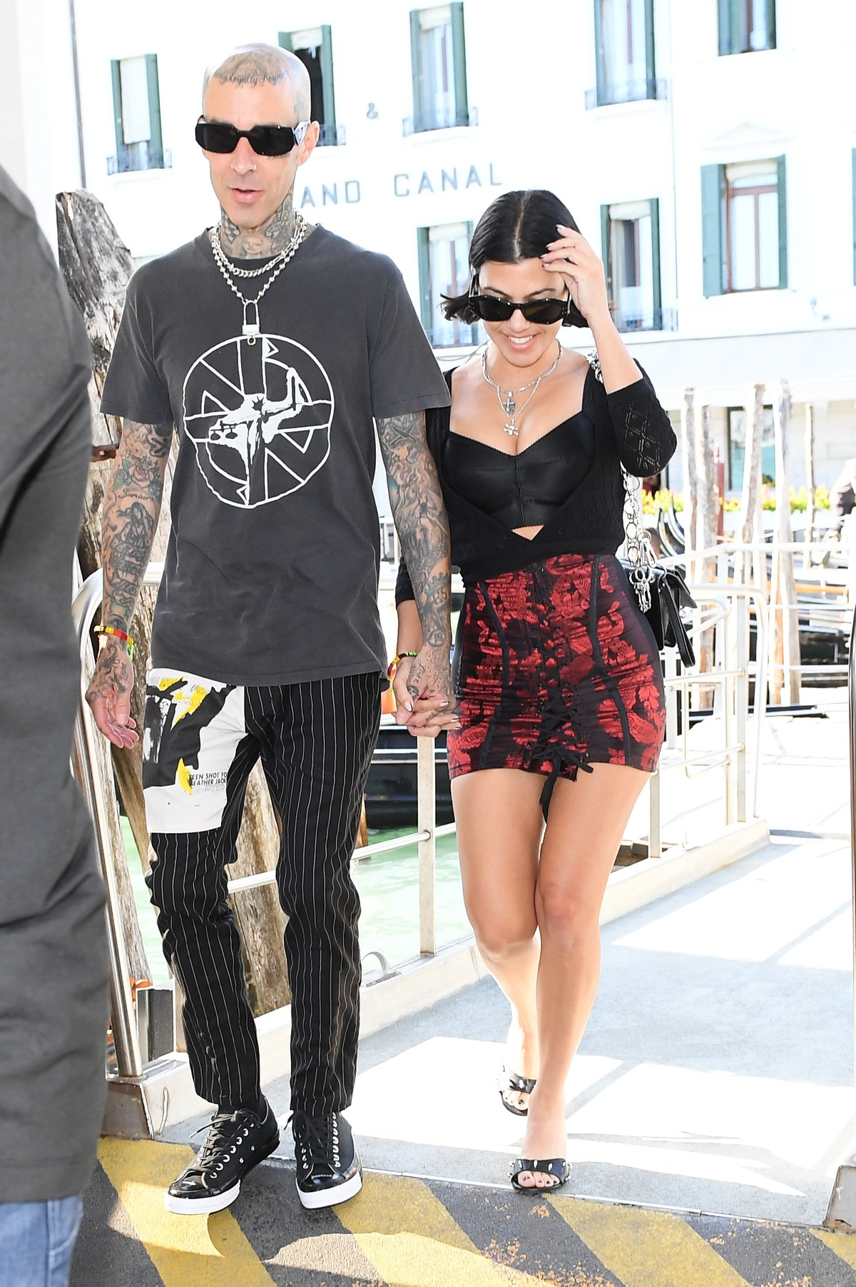 Kourtney Kardashian and Travis Barker are seen walking and smiling on August 29, 2021 in Venice, Ita...