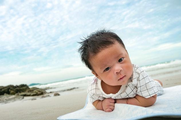 baby on blanket on beach