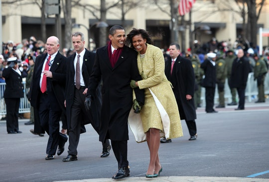 US President Barack Obama and First Lady Michelle walk the Inaugural Parade route after Obama was sw...