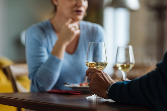 Unrecognisable couple having dinner and wine in a restaurant