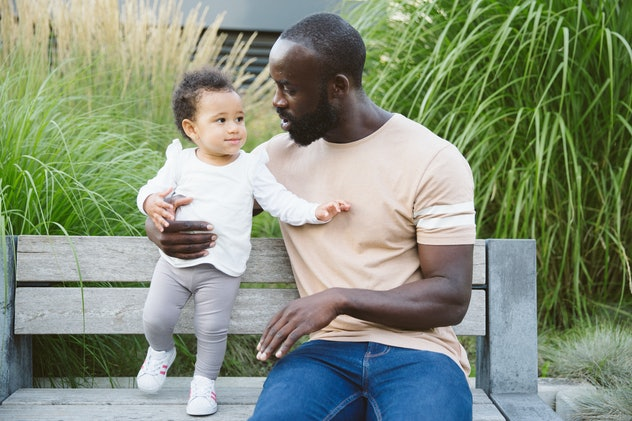 dad with baby girl outside