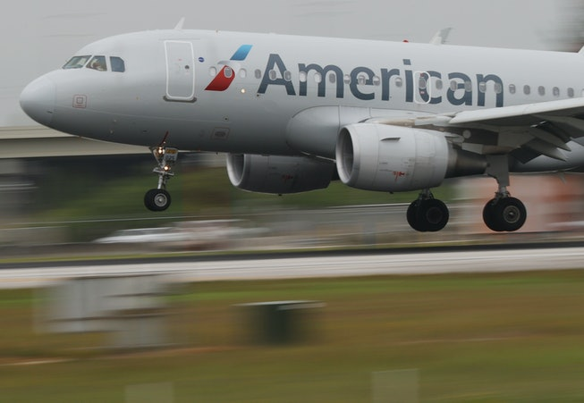 MIAMI, FLORIDA - JUNE 16: An American Airlines plane lands at the Miami International Airport on Jun...