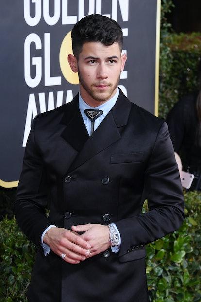 Celebrity Nick Jonas attends the Golden Globes.