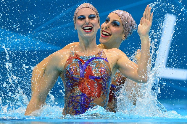 Brazil's Lara Teixeira and Brazil's Nayara Figueira  compete in the duets free routine preliminary r...