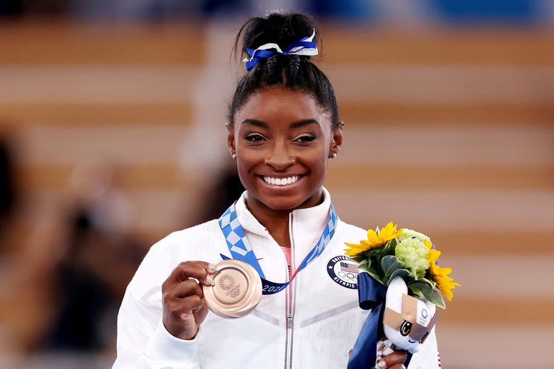 TOKYO, JAPAN - AUGUST 03: Simone Biles of Team United States poses with the bronze medal during the ...