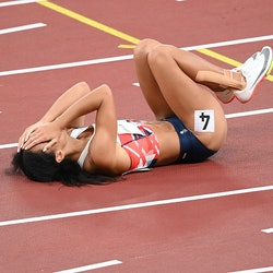 TOKYO, JAPAN - AUGUST 04: Katarina Johnson-Thompson of Team Great Britain reacts as she lies injured...