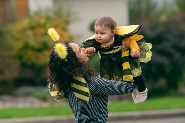 mom and baby in matching bee costumes