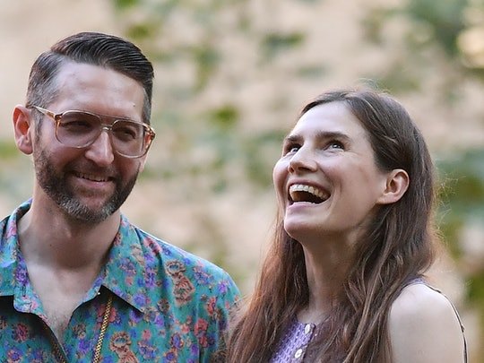 (FILES) In this file photo taken on June 13, 2019 Former US convict Amanda Knox (R) along with her b...