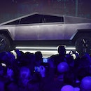 People take pictures of the newly unveiled all-electric battery-powered Tesla's Cybertruck at Tesla ...