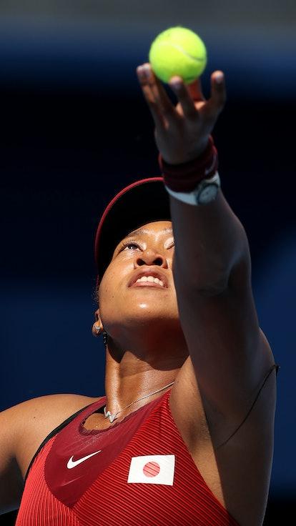 TOKYO, JAPAN - JULY 25: Naomi Osaka of Team Japan serves during her Women's Singles First Round matc...