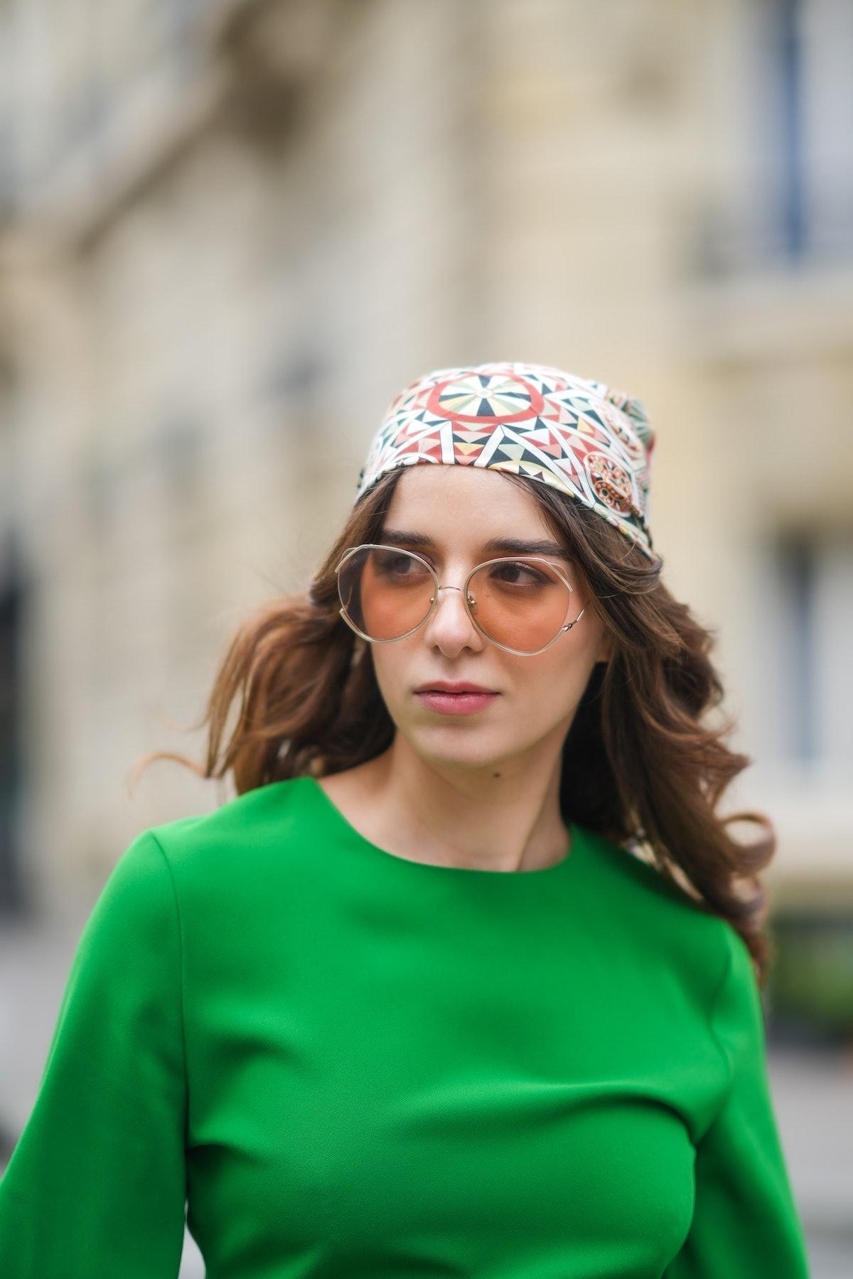 Ketevan Giorgadze  wears a midi green dress with a round neckline from Zara, oversized sunglasses fr...
