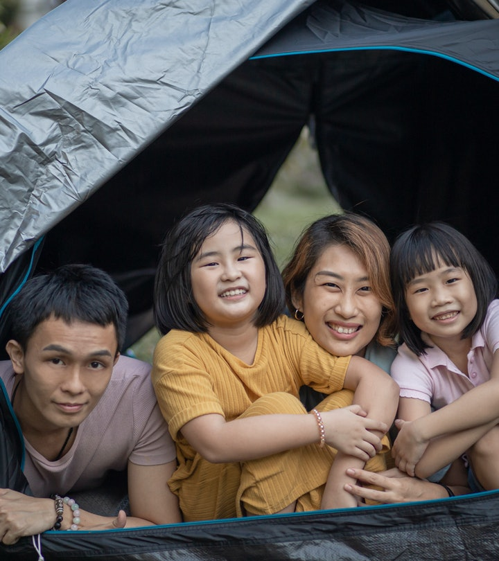 family playing have fun inside camping tent at backyard