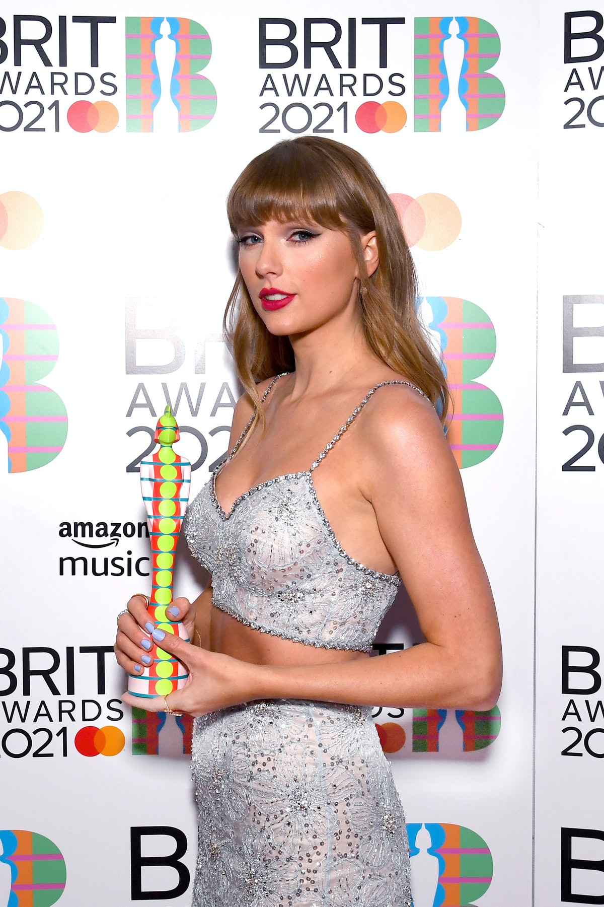 LONDON, ENGLAND - MAY 11: Taylor Swift with the Global Icon award during The BRIT Awards 2021 at The...