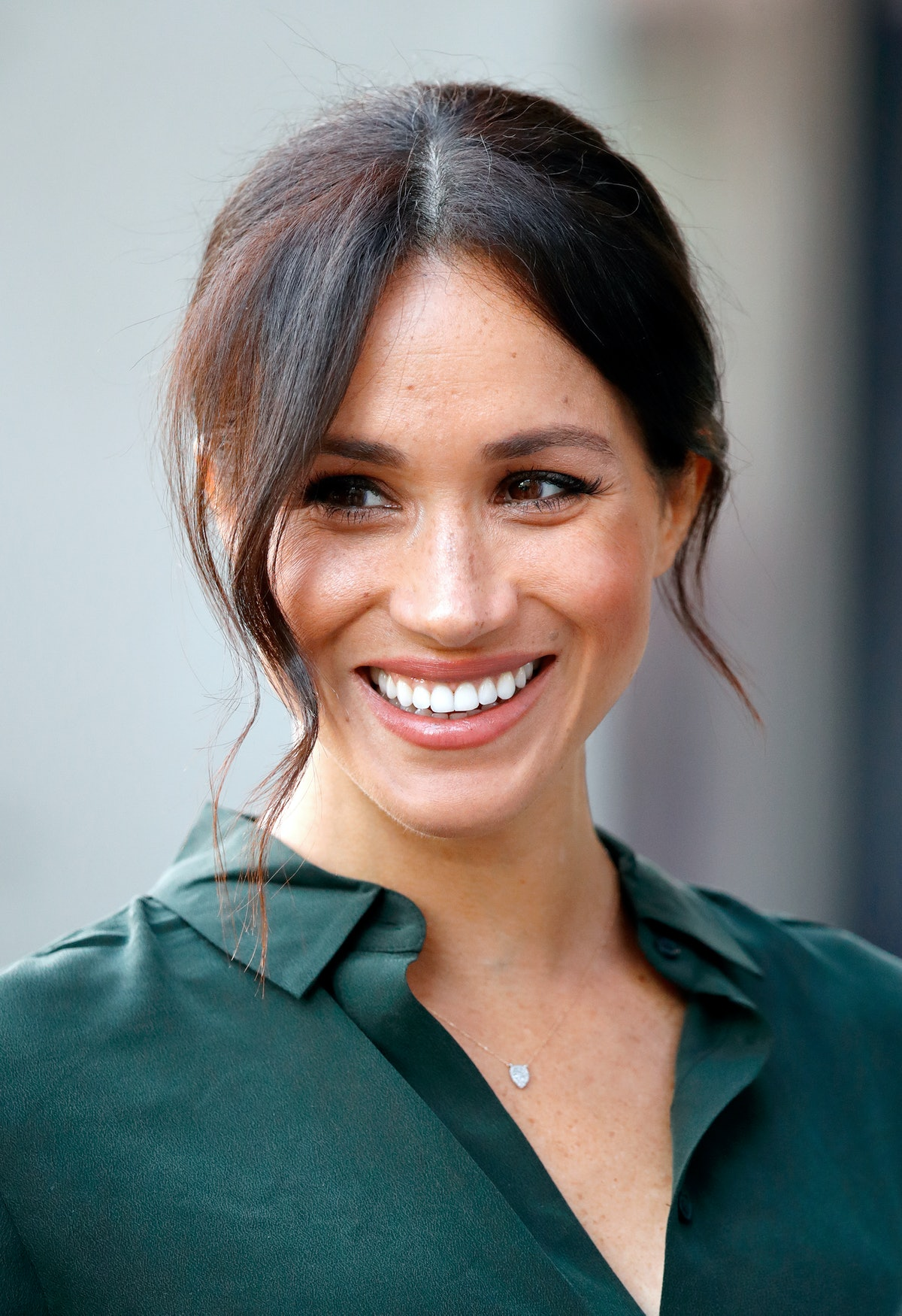 Meghan Markle wears a dainty necklace when visiting the University of Chichester's Engineering and T...