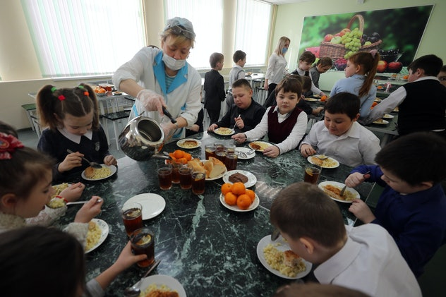 IVANOVO, RUSSIA - MARCH 12, 2021: Children have lunch in a canteen at secondary school No 14. Vladim...