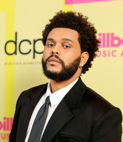 LOS ANGELES, CALIFORNIA - MAY 23: The Weeknd poses backstage for the 2021 Billboard Music Awards, br...