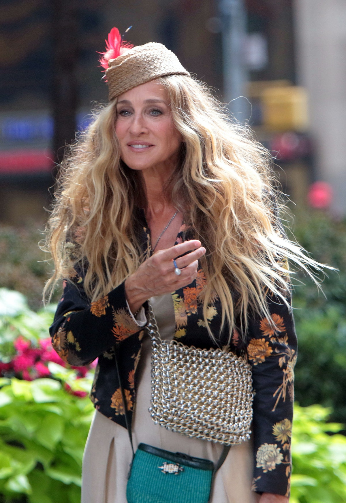 Sarah Jessica Parker photographed in an embroidered jacket and chainmail bag while on set for And Ju...