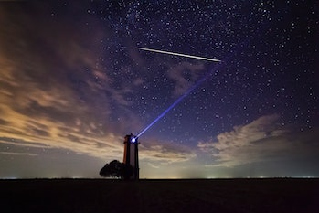 Bright meteor over the lighthouse during the Perseid meteor shower