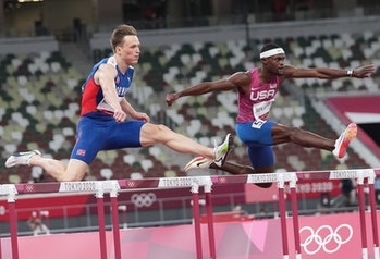 Karsten Warholm L of Norway and Rai Benjamin of the United States compete during the men's 400m hurd...