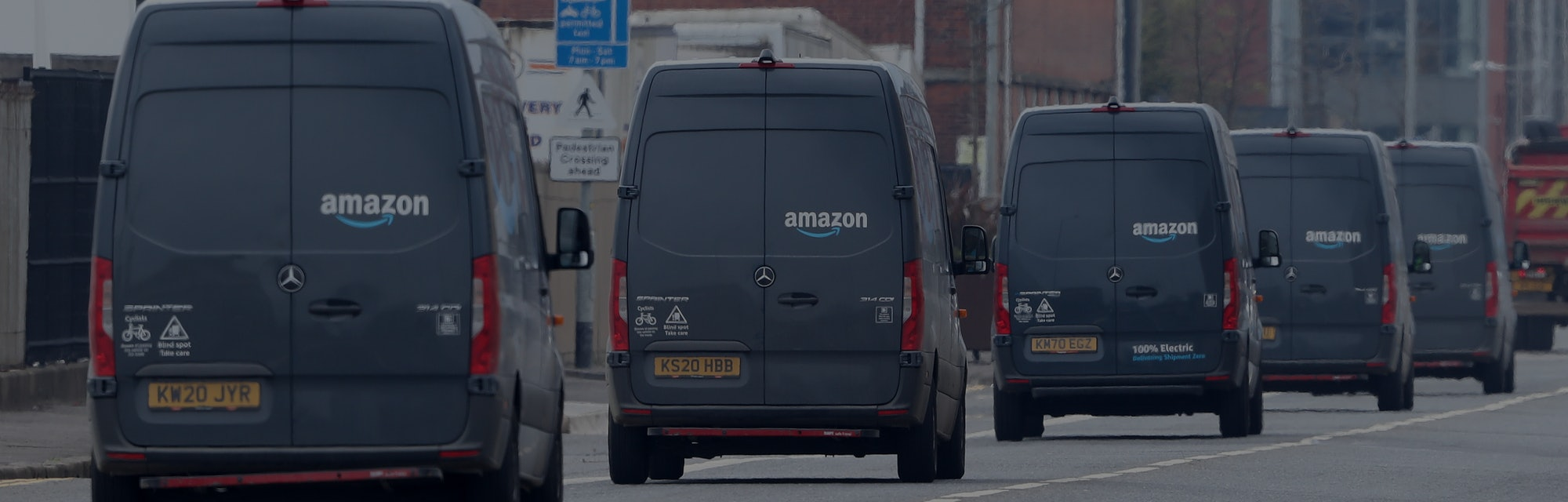 Electric delivery vans leave the Amazon warehouse in the Titanic Quarter, Belfast. Picture date: Wed...