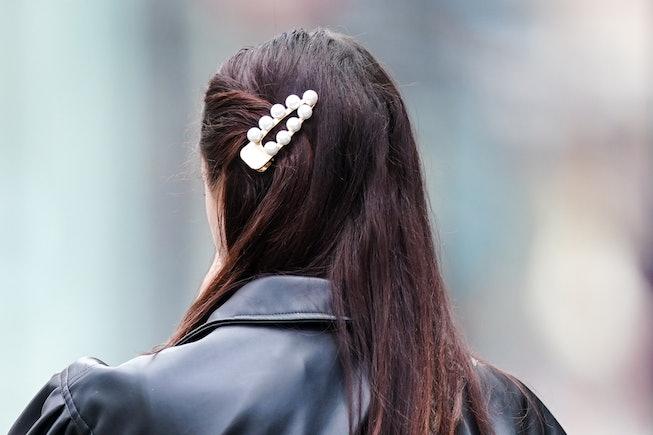 PARIS, FRANCE - JUNE 07: A passerby wears a beaded pearls hair brooch, on June 07, 2020 in Paris, Fr...