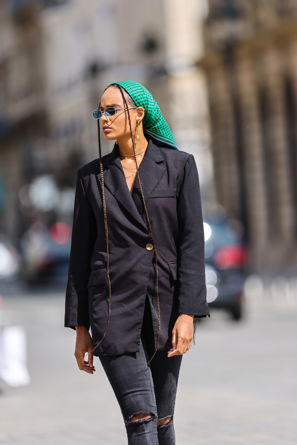 Alicia Aylies wears a green bandana scarf in the way classic early 2000s celebrities wore bandanas.