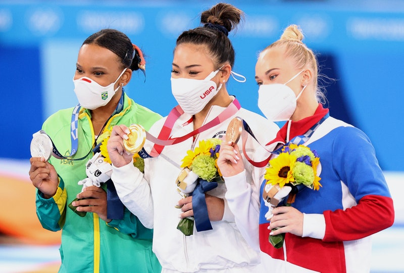 Athletes Rebecca Andrade of Brazil, Sunisa Lee of the US and Angelina Melnikova pose with their Olym...