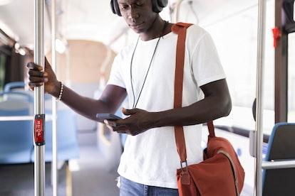 man on subway looking at his phone