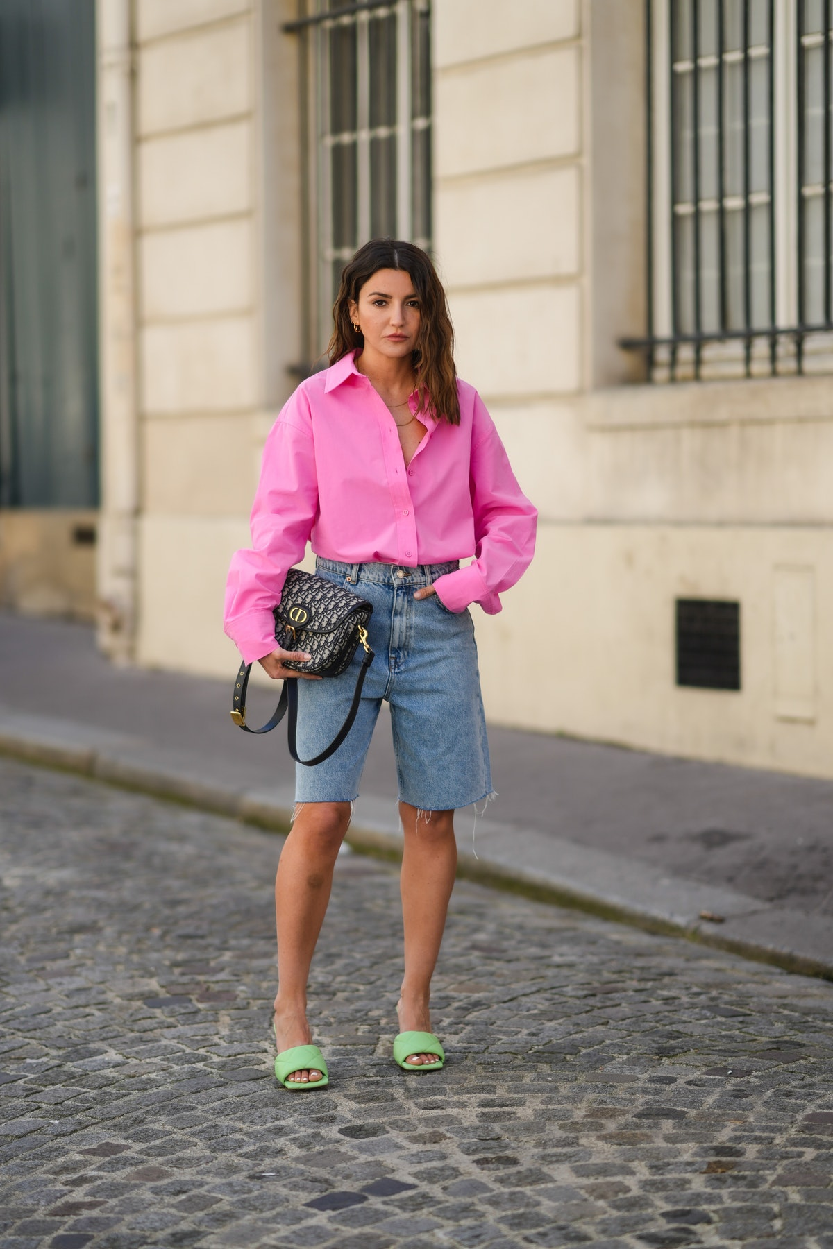PARIS, FRANCE - APRIL 26: Alexandra Pereira wears a neon pink open oversized shirt from The Frankie ...