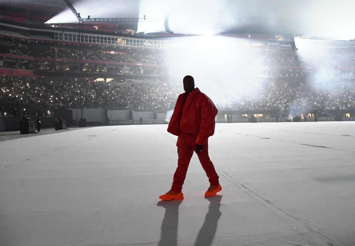 Kanye West is seen at 'DONDA by Kanye West' listening event at Mercedes-Benz Stadium. He's wearing a...