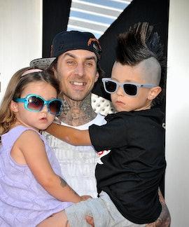 Musician Travis Barker (C) with his children Alabama Barker (L) and Landon Barker (R) arrive at the ...