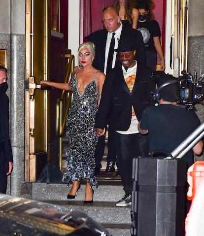 NEW YORK, NEW YORK - AUGUST 05:  Lady Gaga and Michael Bearden leave Radio City Music Hall on August...