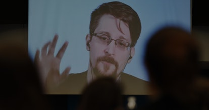 Former US National Security Agency (NSA) contractor and whistle blower Edward Snowden speaks via vid...