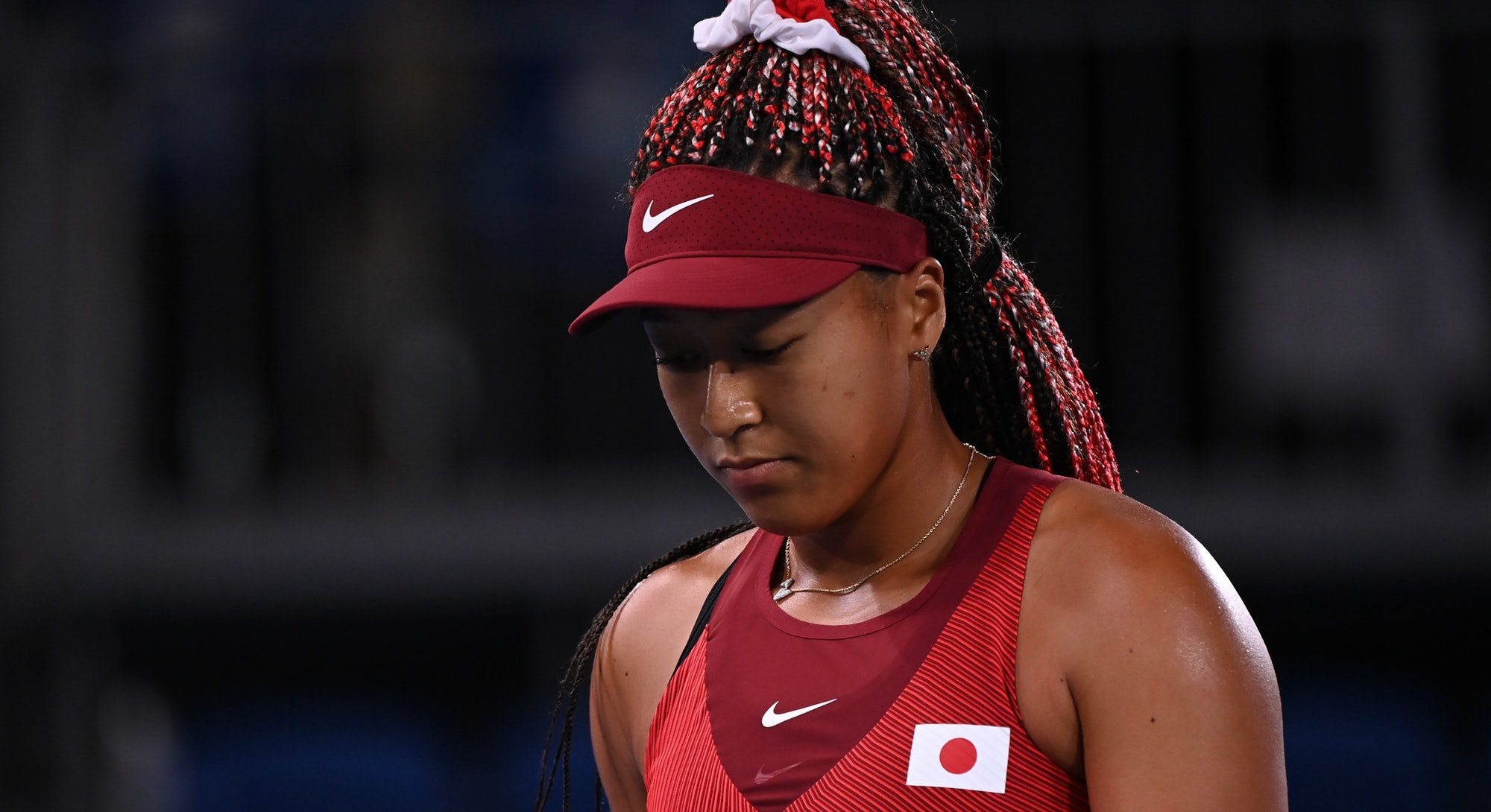 Naomi Osaka's box braids, Suni Lee's eyelash extensions, and Simone Biles' soft glam  were some of t...