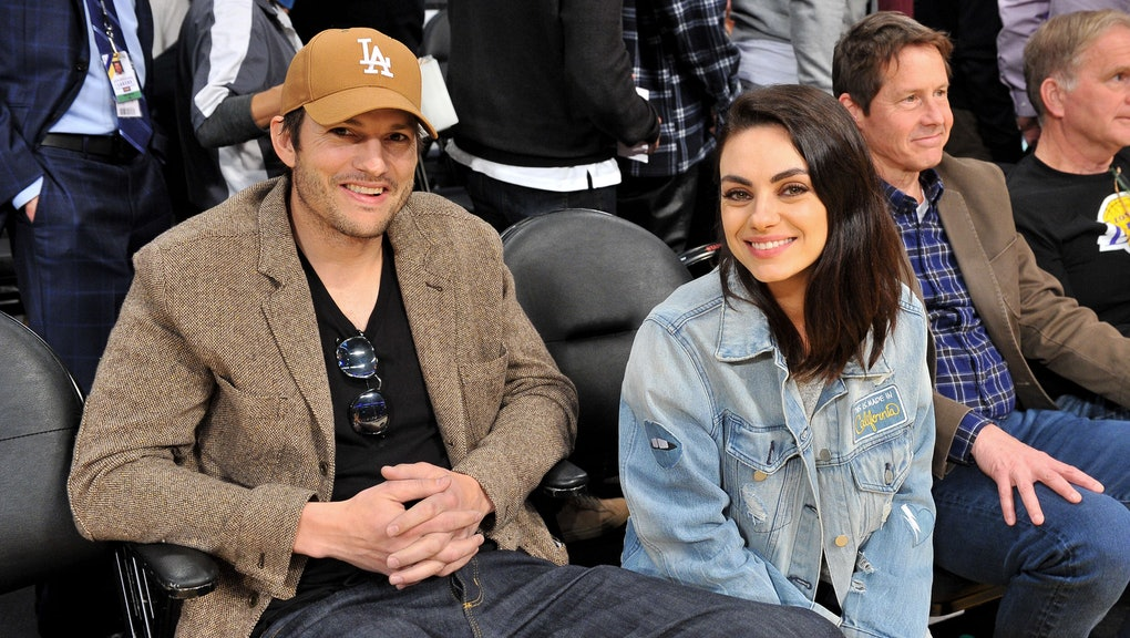 LOS ANGELES, CALIFORNIA - JANUARY 29: Ashton Kutcher and Mila Kunis attend a basketball game between...