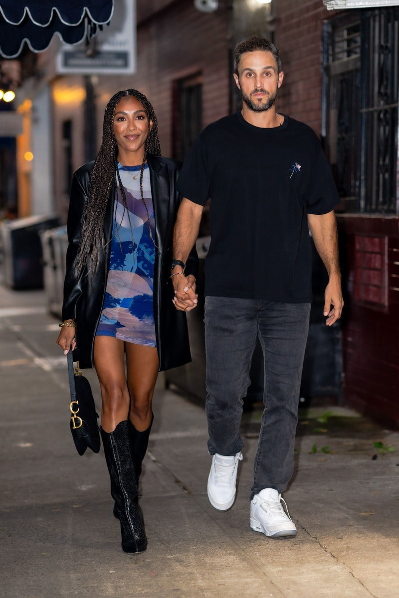 Tayshia Adams and Zac Clark walk hand in hand in New York City.