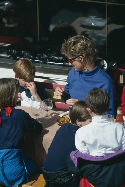 Princess Diana (1961 - 1997) having lunch with her sons Prince Harry and Prince William during a hol...