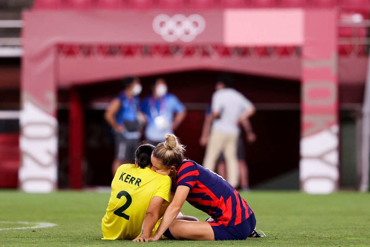Olympians Sam Kerr and Kristie Mewis confirm their romance with a PDA-filled Instagram post.
