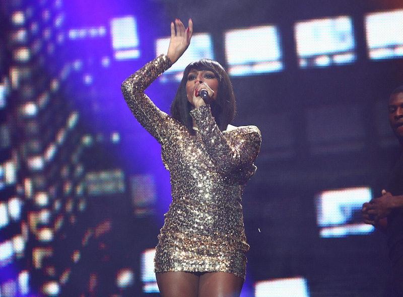 Alexandra Burke singing on stage