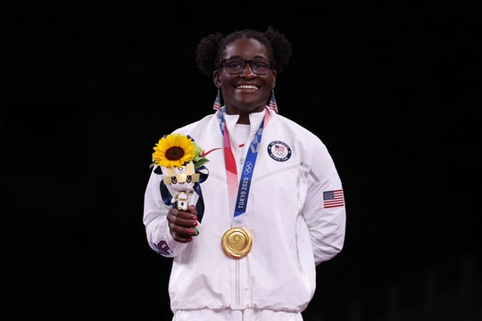 Gold medalist USA's Tamyra Mariama Mensah-Stock poses with her medal after the women's freestyle 68k...