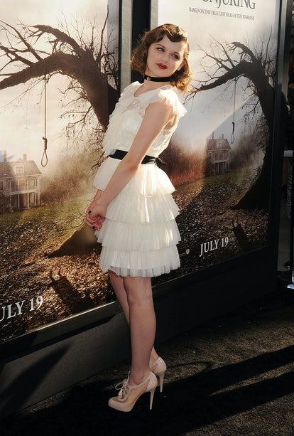"""Joey King takes a picture at """"The Conjuring"""" premiere."""