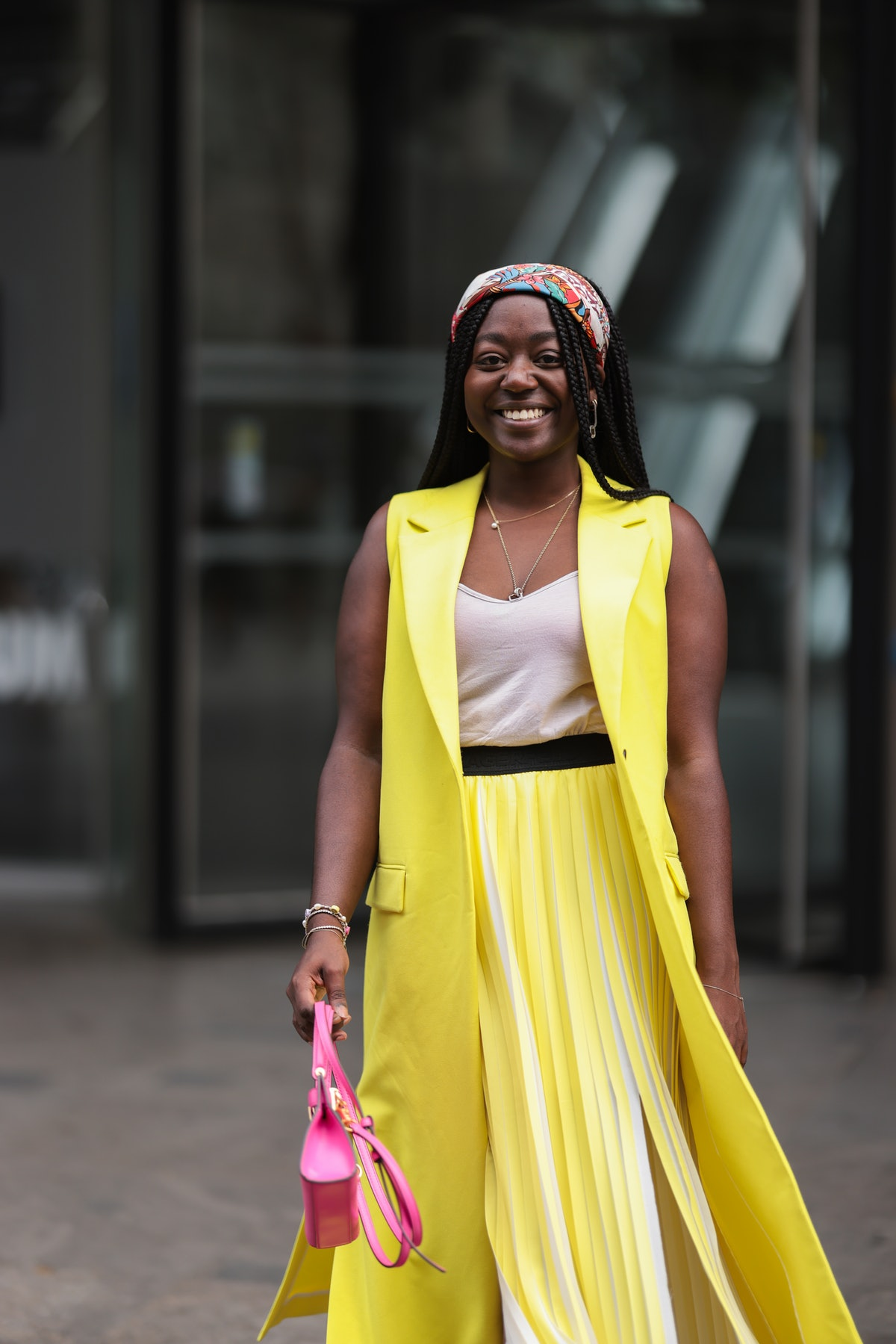 Lois Opoku demonstrates one of the many ways to wear a bandana or patterned scarf.