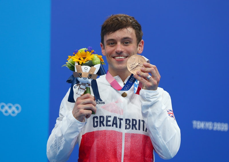Thomas Daley of Great Britain poses during the awarding ceremony after the men's 10m platform final ...