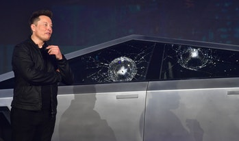 Tesla co-founder and CEO Elon Musk verbally reacts in front of the newly unveiled all-electric batte...