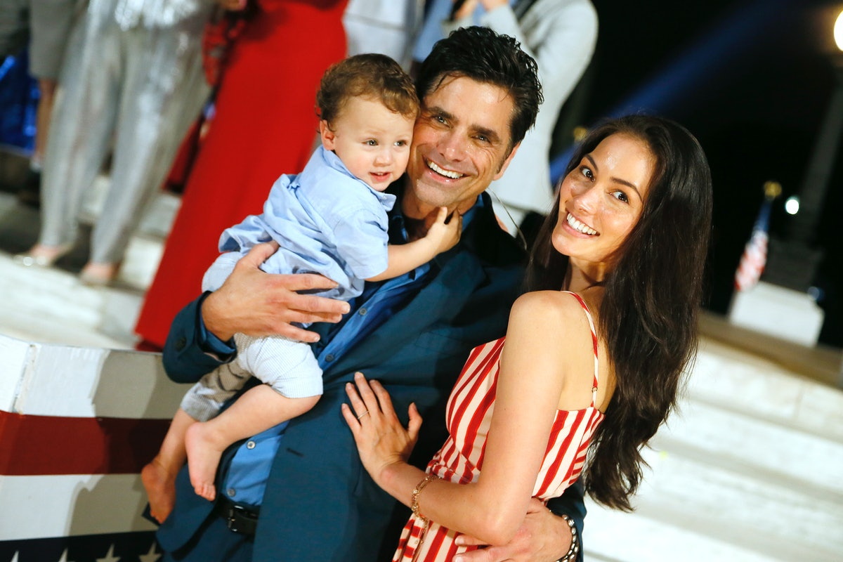 WASHINGTON, DC - JULY 04:  Actor and host John Stamos (C) with his son Billy Stamos and wife Caitlin...