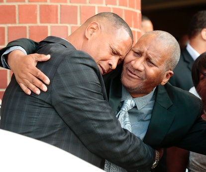 Clarence Franklin, Aretha Franklin's son, hugs an attendee after his mother's funeral at the Greater...