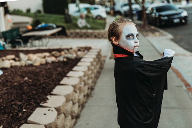 little boy dressed up as dracula