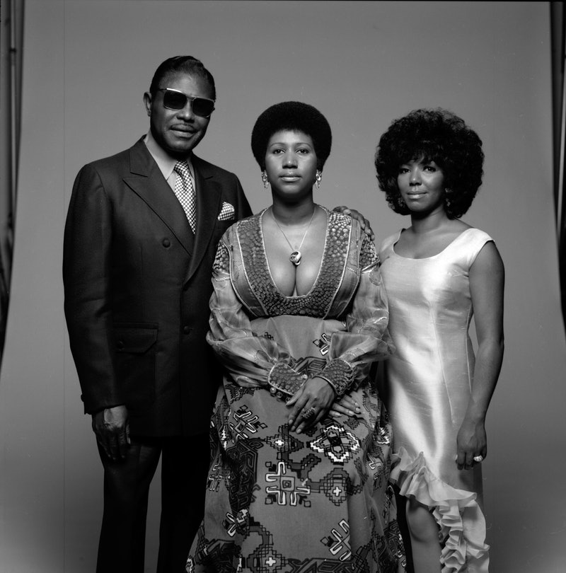 Portrait of American singer Aretha Franklin, her father, Baptist preacher CL, and her sister her sis...