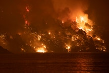 Wildfire approaches the seaside village of Limni, on the island of Evia, Greece, on August 6, 2021. ...